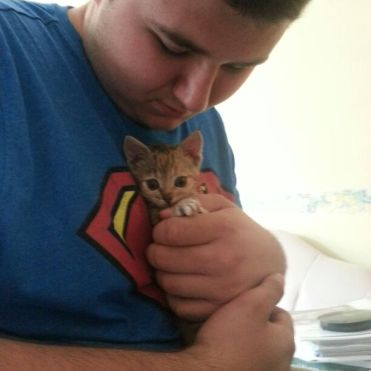 A teeny-tiny Millie, my first furchild, being held by a giant Ross!