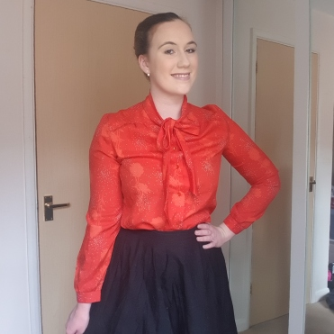 Red, vintage blouse - paired with black circle skirt