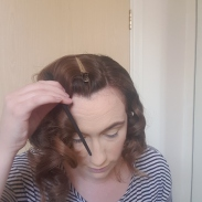 Clipped and pulling the hair forward